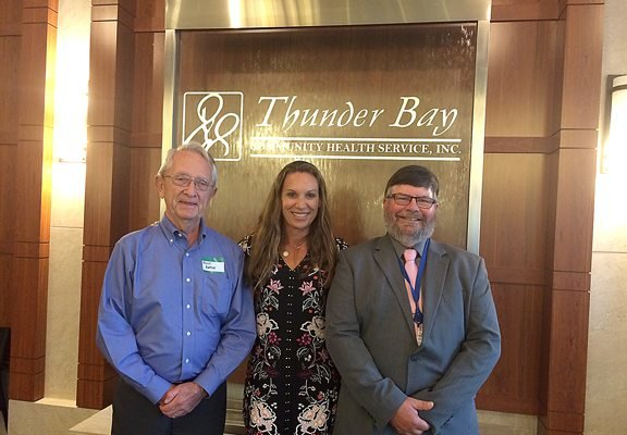News Photo by Julie Goldberg Left to right, founding board member Alvin Bartow, CEO Michelle Styma, and Vice Chair Ben Bolser celebrate the 35th anniversary for Thunder Bay Community Health Services, Inc.